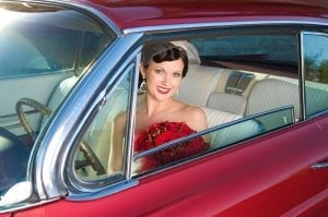 60s bride sitting in red mustang