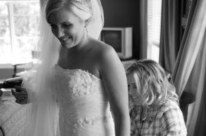 Brides dress laced up the Glen Club Glenview