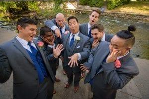 Excited groom groomsmen ring