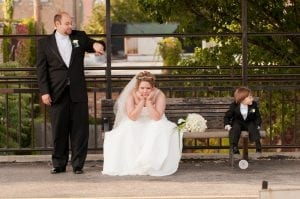 Funny bride groom ring bearer waiting for train